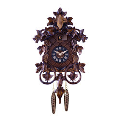 RIVER CITY CLOCKS - One Day Hand-carved Cuckoo Clock with Intricate Leaves & Vines - 14 Inches Tall - This hand-carved German cuckoo clock features intricately carved leaves and vines. It has wooden hands, a wood dial with Roman numerals, and a warm light yellow hand-painted and hand-carved cuckoo bird. Two cast iron pine cone weights are suspended beneath the clock case by two separate brass chains.        The hand-carved maple leaf pendulum continously swings back and forth which controls the timing of the clock. If your cuckoo clock's timing should ever need adjustment, you can control the speed of your clock by sliding the maple leaf up or down the pendulum stick. Sliding the maple leaf down causes the cuckoo clock to run slightly slower, while sliding the maple leaf up makes the cuckoo clock run slightly faster.        On every hour the cuckoo bird emerges from a swinging door above the clock dial and counts the hour by cuckooing once per hour. (Example: At one o'clock the bird will cuckoo once. At eight o'clock the bird will cuckoo eight times) The half hour is announced with one cuckoo call.     The 30 hour all brass mechanical Regula movement, which is produced in the Black Forest of Germany, is wound once per day by raising the two pine cone weights. One weight powers the time and the other weight powers the cuckoo and cuckoo call.    *Great effort has been made to portray each cuckoo clock as accurately as possible.     As with many handmade items, the exact coloration and carving may vary slightly from clock to clock. We consider this to be a special part of their character.     This clock is covered by a two year limited warranty covering workmanship and manufacturers defects.