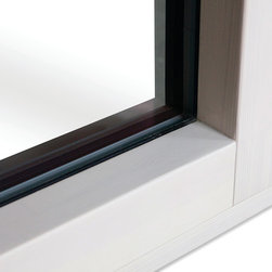 PanoramicView Tilt & Turn WIndow - The new PanoramicView series from Zola Windows offers sweeping views, effortless operation and premium durability with its significantly reduced frame thickness. Zola's new PanoramicView aluminum clad wood windows and doors boast a slender frame, with a sash that is completely hidden in the frame allowing for continuous glass lines between fixed and operable windows.