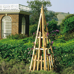 Cedar Plant Pyramid - If your favorite gardener needs help getting vertical, this high-quality cedar pyramid will get the job done. Use for climbing flowers like Clematis or in the veggie garden for beans. It's functional and an architectural focal point in the garden.