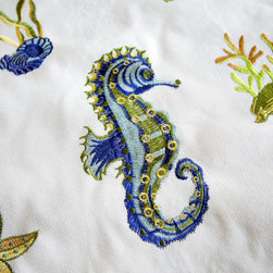 Embroidered seahorse fabric white blue - An embroidered seahorse fabric. This comes in off-white, copper, yellow, and mist blue.