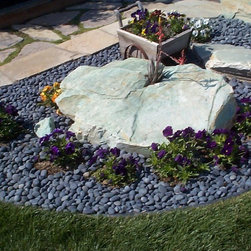 Loose Pebbles - Landscaping stones using our Mexican beach pebbles. Indonesian pebbles, Asian pebbles, and unique marble pebbles are fantastic for interior and exterior design. Use loose pebbles for large areas or to create unique borders and accents that add distinction to any landscape architecture. Our 25 years of creating gorgeous pebble tile or river rock tile give us access to the very finest in pebbles for you discriminating design needs. All pebbles are created from naturally from the unique islands of Indonesia. Meticulously sorted and hand-picked by local artisans for color, size, and thickness.