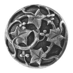 "Notting Hill - Notting Hill Ivy with Berries Knob - Antique Pewter - Notting Hill Decorative Hardware creates distinctive, high-end decorative cabinet hardware. Our cabinet knobs and handles are hand-cast of solid fine pewter and bronze with a variety of finishes. Notting Hill's decorative kitchen hardware features classic designs with exceptional detail and craftsmanship. Our collections offer decorative knobs, pulls, bin pulls, hinge plates, cabinet backplates, and appliance pulls. Dimensions: 1-1/8"" diameter"