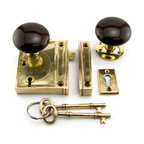 Vertical Rim Lock Set with Brown Porcelain Knobs - Add a historic touch to your home with the Vertical Rim Lock Set with Brown Porcelain Knobs. This door knob set includes skeleton keys and a matching keyhole.