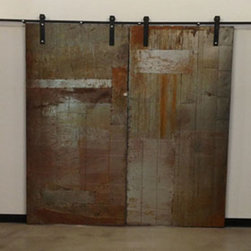 Metal Sliding Doors - Designed to separate and seal between an office work space and a storage warehouse space. Doug Boyd