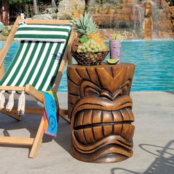 Design Toscano - Design Toscano The Grand Tiki Teeth Sculptural Table - DB383038 - Shop for Tables from Hayneedle.com! Sun surf and fruity drinks make the Tiki gods happy and you can get happy right along with them by adding the Grand Tiki Teeth Sculptural Table to your poolside decor. Made of a faux wood grain resin this table is sturdy fun and full of Tiki charm.About Design Toscano: Design Toscano is the country's premier source for statues and other historical and antique replicas which are available through our catalog and website.We were named in Inc. magazine's list of the 500 fastest growing privately-held companies for three consecutive years - an honor unprecedented among catalogers.Our founders Michael and Marilyn Stopka created Design Toscano in 1990. While on a trip to Paris the Stopkas first saw the marvelous carvings of gargoyles and water spouts at the Notre Dame Cathedral. Inspired by the beauty and mystery of these pieces they decided to introduce the world of medieval gargoyles to America in 1993. On a later trip to Albi France the Stopkas had the pleasure of being exposed to the world of Jacquard tapestries that they added quickly to the growing catalog. Since then our product line has grown to include Egyptian Medieval and other period pieces that are now among the current favorites of Design Toscano customers along with an extensive collection of garden fountains statuary authentic canvas replicas of oil painting masterpieces and other antique art reproductions.At Design Toscano we pride ourselves on attention to detail by traveling directly to the source for all historical replicas. Over 90% of our catalog offerings are exclusive to the Design Toscano brand allowing us to present unusual decorative items unavailable elsewhere. Our attention to detail extends throughout the company especially in the areas of customer service and shipping.
