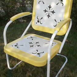 4D Concepts - Outdoor Metal Chair in Yellow - Yellow finish. Outdoor chair is great for all of your outdoor needs. Seats and backrests are trimmed in a vibrant shade of vintage Yellow. Decorative cut out design makes this chair a very stylish and sophisticated look. Metal arms with red metal capped armrest are a finishing touch to an outstanding chair. Clean with a dry non abrasive cloth. Pictured in Yellow. Assembly required. 27 in. W x 22.5 in. D x 35.5 in. H (31 lbs.)