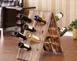 Southern Enterprises Syrah Riddling Sandwich Board Wine Rack - 24 Bottle - The Syrah Riddling Sandwich Board Wine Rack - 24 by Southern Enterprises holds up to 24 wine bottles. The sandwich board or A-Frame style simply supports itself with peg holes to house and display your most popular wine. Constructed from Fir wood with weathered oak finish giving it a unique antique look with the wood plank and deep beautiful wood grain showing through. Folds flat for storing when not in use. Displayed dimensions: 16W x 22.25D x 27.5H inches. About SEI (Southern Enterprises Inc.)This item is manufactured by Southern Enterprises or SEI. Southern Enterprises is a wholesale furniture accessory import company based in Dallas Texas. Founded in 1976 SEI offers innovative designs exceptional customer service and fast shipping from its main Dallas location. It provides quality products ranging from dinettes to home office and more. SEI is constantly evolving processes to ensure that you receive top-quality furniture with easy-to-follow instruction sheets. SEI stands behind its products and service with utmost confidence.