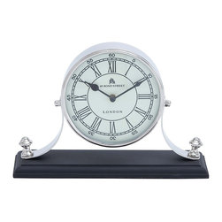Traditional Table Clock with Classic Design - Neat and elegant in appearance, this beautiful Metal nickel plated table clock offers functional use and attractive style, perfect for any setting. This clock features a simple classic design, which can complement traditional settings best. The elegant clock has a round face that is affixed to a firm base, which in turn ensures it is well balanced. The face of the clock features a pristine white color that is complemented with bronze colored Roman numerals. It is perfect for setting on tables or mantles, and can complement all kinds of settings perfectly. It is made from quality metal, which ensures durability. The clock has a sturdy body that is made from quality metal to ensure long lasting performance. This elegant table clock is a perfect gifting option too.. It comes with following dimensions