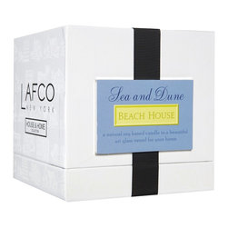 "Lafco House & Home Sea and Dune Candle - This Lafco candle boats 90 hours of burn time with notes of ""salty sea air, dune grass and gentle sea foam."" It's yet another great option for a housewarming gift. Plus, I always stock a few candles just in case — you never know when you might need a last-minute gift."