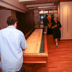 The Balvenie Rare Craft Collection: Veneto Shuffleboard - A close up of curator Dario Franchitti using our Veneto Shuffleboard table in Carmel, California, during Balvenie's Rare Craft Collection Tour.