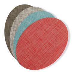 "Design Within Reach - Chilewich Oval Placemats (Set of 4) - Oval placemats for oval and round tables – what a novel idea. In 2010, we asked our friend Sandy Chilewich to design modern placemats especially for our oval tables, featuring her woven vinyl Mini Basketweave, a refined, tight pattern with a light texture. After co-founding the successful HUE hosiery company with Kathy Moskal, Chilewich experimented with different fibers until she stumbled upon woven vinyl, which would become her signature textile. All Chilewich products have a long life cycle, which she says ""helps the user reduce both energy use and costs while maintaining a sophisticated and modern aesthetic."" Made in U.S.A. Oval Placemats available in Red, Turquoise, Gravel and Dark Walnut. Sold in sets of 4 placemats."