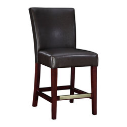 "Powell - Powell Brown Bonded Leather Counter Stool - Brown bonded leather counter stool belongs to miscellaneous bars and game room collection by Powell. The brown leather counter stool is the perfect piece that is sure to complement any decor. The sleek ""Light merlot"" finished legs and the ""Antique brass"" foot rest add a touch of interest to this somewhat simple piece. The stool is covered in dark brown bonded leather. The seat height measures 24"". Some assembly required."