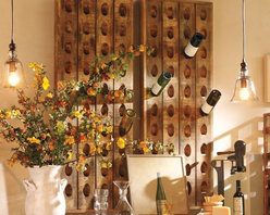 French Wine Bottle Riddling Rack - As you know, the French truly love their wine. What better way to display your spoils than with this rustic wine rack? It would look lovely against a shade of white on the walls.