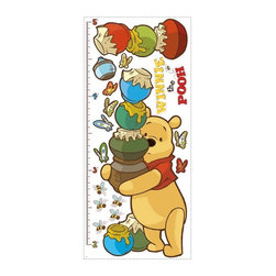 RoomMates Peel & Stick - Winnie the Pooh - Pooh Growth Chart - Watch your little ones grow with the help of this adorable Pooh and Friends peel and stick growth chart. The chart assembles easily on the wall, and can be moved and reused over and over again. It's the perfect way to keep track of important milestones with the help of Winnie the Pooh and his friends! Match it with our other Pooh and Friends designs (not included) to create a theme in a bedroom, nursery, or playroom. Winnie the Pooh and Tigger, too! Celebrate the timeless tale of Winnie the Pooh and his friends with our selection of adorable Winnie the Pooh wall decals, pre-pasted borders, growth charts, and wallpaper. Our Pooh and Friends wall decor collection is the perfect way to decorate a nursery or child's room!