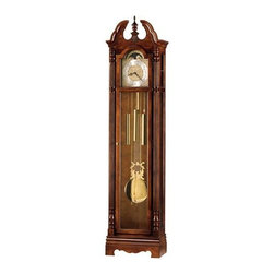 Howard Miller - Howard Miller - Jonathan Floor Clock - Time gallivants from stoke to stroke in this matchlessly crafted, cherry and brass Kieninger grandfather floor clock featuring silence option, swan neck pediment, a shell overlay and a myriad of jeweled detailing to enrich your room's d̩cor with luxurious charm and style. * Features a swan neck pediment, and a shell overlay at the base of the turned finial. . The polished and brushed brass dial offers ornate corner spandrels and center disc with a stationary blue moon phase. . Substantially turned and reeded columns accent each side. . Polished brass pendulum and weights are visible behind the full length glass panels. . Chain-driven, Westminster chime Kieninger movement with chime silence option. . Finished in Windsor Cherry on select hardwoods and veneers. . You will receive a free heirloom plate, engraved with name and date, by returning the enclosed request card to Howard Miller. . Locking door for added security. . Manufacturer's 2 Year Warranty. 82 1/2 in. (210 cm) H x 20 in. (51 cm) W x 11 1/4 in. (29 cm) D