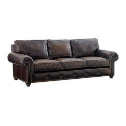 Lexington - Tommy Bahama Home Kilimanjaro Riversdale Leather Sofa - Outfit your living room in casual luxury with this beautiful centerpiece. This traditionally-styled sofa displays handsome rolled arms with exposed wood face panels. Adding a touch of rich detail to the sofa are nailhead studs along the arms and button-tufting on the base rail. Sofa boasts super plush seat cushions made of down-wrapped foam tucked in a feather-proof ticking, alongside a sink-in back cushion filled with natural down and polyester fibers.