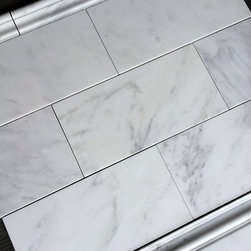 """$8.00SF Carrara 6x12"""" Marble Subway Tile - Carrara Venato 6x12"""" Marble Tile.  Thebuilderdepot.com offers retailers, contractors, installers and home owners access to the highest quality of marble subway tile, trims and mosaics by being the exclusive USA supplier of Carrara Venato marble."""
