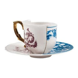 Seletti Hybrid Collection, Euremia Coffee Cup & Saucer, Set of 2 - The Hybrid Euremia set includes two cups and two saucers. Italian to the bone, the set was designed by CtrlZak for Seletti and made of bone china, a material known for its strength, chip resistance, whiteness, and translucency. The floral patterns were refined by hand in blue and maroon. Representing Eastern and Western traditions, the designs come together with a golden seam in the middle and differing heights of the cup, embracing contrast and giving tea time a taste of deconstructed, punk style. Stunning, functional, and recommended by Elle Magazine in their December 2012 gift guide, the set is heat- and dishwasher-safe, ready for the table.