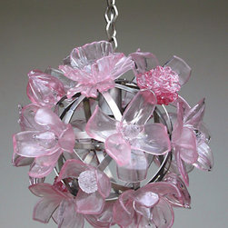 Elizabeth Lyons Glass Pink Chandelier - This glass floral chandelier is a bit girly yet the blossoms sprout from a metal armature globe and hang from a metal chain. Each flower is hand-sculpted and will catch your eye each time you look at it.