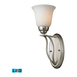 Elk Lighting - Malaga LED 1-Light Sconce in Brushed Nickel - With clean and flowing style, this series has sophisticated double arm construction with a subtle arch that gracefully supports flared glass. A choice of finishes include brushed nickel with opal white glass or aged bronze with antique amber glass. - LED offering up to 800 lumens (60 watt equivalent) with full range dimming. Includes an easily replaceable LED bulb (120V).