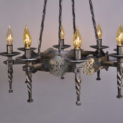 Spanish Revival Chandelier - 8 bulb - The client and I collaborated on the design of 3 sizes of chandeliers as well as 2 styles of sconces to be placed throughout his Spanish Colonial Revival style home. These lights mimic the cross details that appear throughout the client's home. We also played off of the home's existing decorative iron trim, iron spiral staircase, and wrought iron balconies. I created more authentic and masculine looking fixtures by adding extensive texture, thereby avoiding the appearance of mass-produced sheet metal pieces.