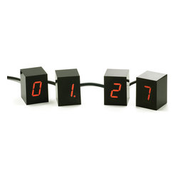 Jonas Damon/Areaware - Jonas Damon - Areaware - Numbers LED Clock Red - An alarm clock consisting of four 2 inch tall cubes. Each cube displays one glowing Red LED digit to make up the time display. Unlike static boxes usually associated with alarm clocks, this interactive collection of changing numbers can be arranged in any configuration.