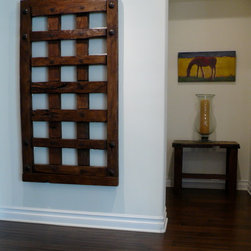 Spanish Colonial / Calabasas - Entry hall to billiard room showcase the Mexican Jail door and small antique door side table with glass hurricane.  Painting by Bill Woolway.