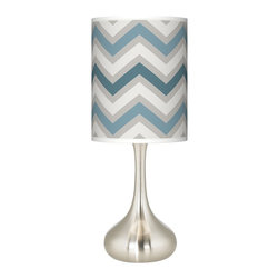Giclee Glow - Wave Zig Zag Giclee Kiss Table Lamp - A soothing azure tone washes over the Wave Zig Zag giclee print shade, lending calming hues to this brushed steel table lamp. Refined simplicity is yours with this modern table lamp design. The metal base offers a graceful sculpted shape that's presented in a brushed steel finish. Topped with a giclee cylinder shade that's custom printed with a stylish Wave Zig Zag pattern. U.S. Patent # 7,347,593.