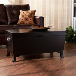 Southern Enterprises - Southern Enterprises Forney Cocktail Table Trunk - Black - HN1690-3 - Shop for Tables from Hayneedle.com! In small spaces multitasking is a must-do - and that makes the Southern Enterprises Forney Cocktail Table Trunk - Black a must-have. Crafted with durable MDF hardwoods and birch veneer this transitional piece doubles as a cocktail table and a generous storage chest. The flat top - perfect for movie snacks and morning coffee - lifts to an open compartment for blankets books and more. A deep black finish silver door knocker-style handles and simple pedestal feet are tailored touches. About SEI (Southern Enterprises Inc.)This item is manufactured by Southern Enterprises or SEI. Southern Enterprises is a wholesale furniture accessory import company based in Dallas Texas. Founded in 1976 SEI offers innovative designs exceptional customer service and fast shipping from its main Dallas location. It provides quality products ranging from dinettes to home office and more. SEI is constantly evolving processes to ensure that you receive top-quality furniture with easy-to-follow instruction sheets. SEI stands behind its products and service with utmost confidence.
