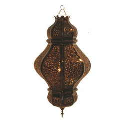 Middle Eastern Artisans - Tin Lamp - Cast romantic shadows throughout your room when you illuminate this pierced tin lamp. Simply add a 75-watt bulb and decide where to hang this Moroccan lamp. It would add great style to the corner of a room or, clustered with two more lamps, would make a stunning centerpiece to a dining room.