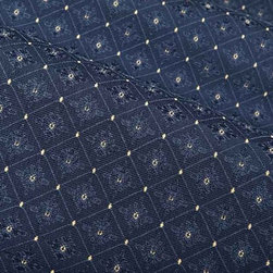 Sofiette Fabric in Navy Blue - Sofiette Fabric in Navy Blue is a trellis patterned, woven upholstery fabric or bedding and pillow fabric with yellow accents. Perfectly textured with a subtle medallion pattern, this fabric has a french countryside feel perfect for traditional or rustic interior designs. Made from 55% rayon and 45% polyester this fabric passes 6,000 double rubs on the Wyzenbeek Abrasion Test. Cleaning Code: S; UFAC: Class I; passes CA117 Test. Width: 54″; Repeat: 2″ V; 2″ H