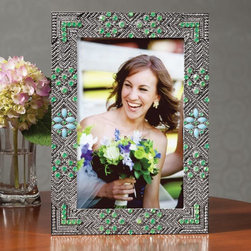 "Olivia Riegel - Dakota Picture Frame - Overview Gorgeous turquoise beads and sparkling Swarovski crystals, arranged in an adaptation of traditional beadwork patterns, adorn this sparkling picture frame. Enchanting and elegant, its the perfect accent for a side table, desk or dresser and makes a wonderful gift.  Features Green Swarovski crystals Turquoise beads Satin grosgrain back Sliding clasps on rear Horizontal or vertical display Swarovski crystal picture frame comes in a beautiful gift box  Specifications  Measures 5 1/4"" x 7 1/4"", holds a 4"" x 6"" photo"