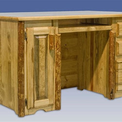 "Montana Woodworks - Glacier Country Executive's Office Desk - Handcrafted . Laminated top. Edge glued. Full extension. Ball bearing slides on the keyboard tray. Letter sized file drawer. Computer tower slide out. Full extension slides. Perfect for the executive who has a cluttered desktop. 20 years limited warranty. Made from solid American grown pine. Hand-crafted in the US, each Montana Woodwork product is made from unprocessed, solid wood that highlights the character of its source tree with unique knots and grains. Made in USA. No assembly required. 63 in. W x 40 in. D x 31 in. HSimilar in design to our standard computer desk, Montana Woodworks executive's computer desk is designed with the hardworking executive in mind.The front side features a modest overhang to allow clients or guests the opportunity to pull up to the desk for signatures, etc. Finished in the ""Glacier Country"" collection style for a truly unique, one-of-a-kind look reminiscent of the Grand Lodges of the Rockies, circa 1900. First we remove the outer bark while leaving the inner, cambium layer intact for texture and contrast. Then the finish is completed in an eight step, professional spraying process that applies stain and lacquer for a beautiful, long lasting finish."