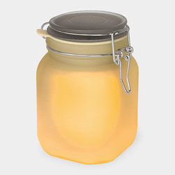 Sunjar Solar Lamp - This classic Mason jar has been given an ecofriendly makeover: Its cell battery is charged by the sun and powers three LED lights that provide a diffused and warm light by night. It's completely watertight.