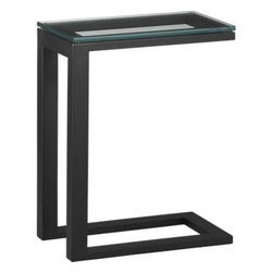 """Parsons C Table with Clear Glass Top - Clean simple lines in a cool """"C"""" to slide under sofas and chairs for up-close-and-personal serving. Hot-rolled steel base is hand-welded and ground at each corner to create a raw, torched millscale finish. Thick glass top has smooth, polished edges."""