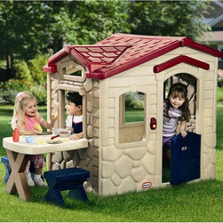 Little Tikes - Little Tikes Picnic on the Patio Plastic Playhouse - 403U - Shop for Tents and Playhouses from Hayneedle.com! Come join us for a picnic! The Picnic on the Patio Playhouse will help your children to imagine and engage in role play. This durable plastic playhouse can be used indoors or outdoors and features a working door and a patio table with two included stools. The kitchenette inside features pretend burners an oven cupboards and a fireplace. A mail slot and picture windows add a realistic touch to the pretend siding and stone construction. Your children will enjoy hours of fun passing meals from the kitchen through the window to guests at the patio table. The electronic doorbell makes 6 fun sounds for exciting realistic play. The included 19-piece accessory set includes play food tableware and a pretend phone. This traditional playhouse requires three AAA alkaline batteries (not included). The playhouse is made in the USA and the doorbell and food pack are made in China. With a versatile playhouse like this one your children will be excited to imitate real life and learn as they grow. Order one for your family today. About Little TikesFounded in 1970 the Little Tikes Company is a multi-national manufacturer and marketer of high-quality innovative children's products. They manufacture a wide variety of product categories for young children including infant toys popular sports play trucks ride-on toys sandboxes activity gyms and climbers slides pre-school development role-play toys creative arts and juvenile furniture. Their products are known for providing durable imaginative and active fun. In November of 2006 Little Tikes became a part of MGA Entertainment. MGA Entertainment is a leader in the revolution of family entertainment. Little Tikes services the United States from its headquarters and manufacturing facility in Hudson Ohio but also operates several manufacturing and distribution centers in Europe and Asia.