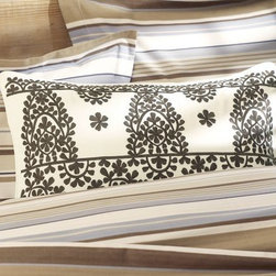 Medina Embroidered Lumbar Pillow Cover - I love the Moroccan-inspired medallions on this pillow cover from Pottery Barn. It feels like a fresh take on the traditional style.