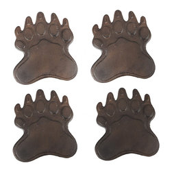 Zeckos - Set of 4 Cast Iron Bear Footprint Garden Stepping Stones - This set of cast iron bear footprint garden stepping stones is a great addition to gardens, flower beds and patios. Each footprint measures 10 inches by 8 1/2 inches, and is 1/4 of an inch high. They have a distressed brown enamel finish that gives them an aged, rusty look. They won't crack or chip like resin or stone stepping stones, so they are great for areas that freeze in winter. Use multiples to create pathways in your garden, or use a single one between your patio and lawn as a decor piece.