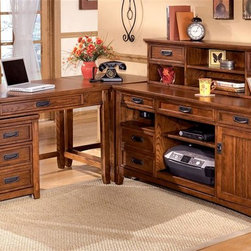 Signature Design by Ashley - 5 Pc Desk Credenza Set - You will love this large five piece office set to keep your home organized and neat. Comes with a desk, hutch, corner table, desk return, and file cabinet so you can keep all of your paperwork and supplies neatly stored away. All items have a dark oak finish that easily compliments any home decor. Set includes: Large Credenza, Corner Table, Large Low Hutch, Small Leg Desk, and Mobile File Cabinet. Color/Finish: Dark Oak Stained. Traditional mission styling with a medium brown oak stained finish. Constructed with oak veneers and hardwood solids. Desk hutch features light and closed storage. Modular desk has laptop drawer w/ internet port and electrical outlet. File cabinet drawer features full extension side mount roller glides. Metal file holders and a key lock are also a feature of the file cabinet. Pull-out keyboard tray is covered with black PVC for durabilityDimensions:. Large Credenza: 61 in. W x 22 in. L x 30 in. H. Corner Table: 28 in. W x 22 in. L x 30 in. H. Large Low Hutch: 58 in. W x 10 in. L x 14 in. H. Small Leg Desk: 48 in. W x 28 in. L x 30 in. H. Mobile File Cabinet: 18 in. W x 22 in. L x 24 in. H