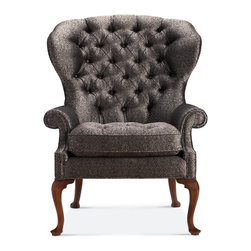 George II Wing Chair - Baker Furniture - This fine George II mahogany Wing Chair features an unusually rounded and flared back support in a deep button tuft.The fitted upholstered seat is flanked by scrolling arm supports. The chair rests on shaped cabriole legs that terminate to pad feet. Shown here in the Brandy finish, the chair is offered in any of the twenty Baker finishes. English c. 1750.