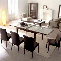 Calligaris - Glass & Wood Extending Table w High Back Dini - Choose Glass Top: Frosted Checkered GlassPictured with Frosted Checkered Glass. Includes: Table & 4 Chairs. Walnut finish Bon Ton table is the perfect solution for dining or living rooms. Suitable for everyday use but can double its extension to seat extra guests. Just slide the rectangular glass top sideways to lift the glass extension leaf into place. Both frame and legs are made of wood. Chair features Wenge frame & coffee upholstery. Elegant upholstered chair with wooden legs, suitable for living & dining areas. High upholstered backrest and seat supported by elastic belts make this an extremely comfortable chair. Covered in Vintage: a leather-look coated fabric that is highly resistant, practical and easy to clean. Assembly required. Chair:. Seat height: 18.5 in.. 18.5 in. W x 20.375 in. D x 36.25 in. H. Table:. Expandable to 94 in. L. 35 in. W x 47 in. D x 29.5 in. H
