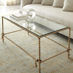 "Horchow - Chloe Coffee Table - We've never seen anything quite like this gorgeous table made to look just like rope, complete with knots and tassels at the corners. Handcrafted of iron. Antiqued-gold finish. Includes a glass top. 44""W x 25.75""D x 19""T. Imported."