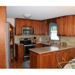 Kitchens - Beautiful, functional, affordable kitchen cabinets and counter tops with coordinating back splash.
