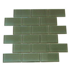"Spa Glass - Light Green 2X4 Subway Glass Tile, Light Green, 2x4, Carton - CARTON of Light Green 2X4 subway glass tile consisting of 20 square feet or sheets. This tile is manufactured in a thinner 1/8 inch thick format and is a high quality ""POOL RATED"" glass subway tile that is perfect for a kitchen backsplash, bathroom tile, shower tile or pool tile. Because the tiles are thinner and come mesh mounted in a staggered interlocking brick pattern, installation is much easier and much less expensive. The thinner profile eliminates the need for tear outs or large demolitions. You can tile over existing materials and eliminate installation cost ( think DIY).These are a very high grade glass subway tile kilned at 800 Celsius for maximum durability and come with a baked polypropylene backing which reflects the color back thru a very clear glass.  The tiles come in a 12X12 inch sheet consisting of 18 tiles 2X4 inches in size.  They come in boxes of 20 square feet or 20 sheets. There is also a SAMPLE option so you can confirm the color is perfect for your space. The Price listed is for a single CARTON OF 20 SQUARE FEET."