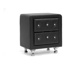 "Wholesale Interiors - Stella Crystal Tufted Black Upholstered Modern Nightstand - Stella is a glamorous designer nightstand that takes it up a notch with allover faux crystal button tufting. Crystal lookalike buttons adorn the front of the bedside table's two drawers and truly glimmer with even the slightest bit of light. Black faux leather is accented by chrome-plated metal legs. This Malaysian-made modern nightstand is built with a plywood and hardwood frame, which is padded with foam before being upholstered. The designer nightstand, which requires minor assembly, is also available in white (sold separately). Keep an eye out for the matching bed, floor mirror, and bed-end bench (also sold separately). To clean, wipe with a damp cloth. Product dimension: 20.25""W x 16""D x 23.75""H , drawer(2): 14.5""W x 12.75""D x 5.62""H."