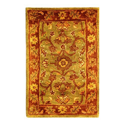 Safavieh - Wool Rug in Green with Rust Border (2 ft. 3 in. x 4 ft. Oval) - Size: 2 ft. 3 in. x 4 ft. Oval. Green and rust-colored accents abound on this floral inspired area rug. Leaf designs highlight border for added appeal. Soft, supple rug is woven with natural wool. Hand Tufted.