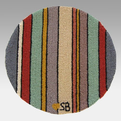 Susan Branch - Susan Branch Seashore Stripes 15 in. Round Chair Pad - SB-0040-2 - Shop for Rugs and Runners from Hayneedle.com! Perfect for casual settings the Susan Branch Seashore Stripes Chair Pad adds comfort and style to regular old kitchen chairs. This round pad is hand-hooked from 100% wool at a density of 90 lines per square foot for a dense rich texture. It measures 15 inches in diameter and is backed with monk's cloth a heavy basket-weave cotton that stands up to plenty of use and adds a charming touch. This chair pad comes complete with easy cleaning instructions and is designed for indoor use in residential or commercial settings.About Thorndike MillsRooted in a proud Armenian family tradition Thorndike Mills developed in Boston during the first half of the 20th century. Their dedication to the quality traditions of Armenian rug-making remains true today. With an emphasis on exact specifications materials that meet high levels of quality and rigorous construction standards they're a top producer of braided rugs for homes and businesses across America. Thorndike Mills is the only manufacturer who still produces true cloth braided rugs made with three strands woven together and then wrapped; the next best option would be a handmade rug. The true quality of the rugs lies in the little details like hidden joints guaranteed color matching perfect symmetry of design and durable lock-stitch sewing. Thorndike Mills is still owned today by the third generation of the founding family.About Susan BranchSusan Branch is a self-taught artist from the Martha's Vineyard area who creates delicate organically inspired works that celebrate nature and simplicity. She has previously been featured in magazines including Country Living and American Patchwork and Quilting. Susan is best known for her beautiful watercolor illustration work which graces her 14 published books as well as a line of china stationery pajamas and her popular yearly calendar.