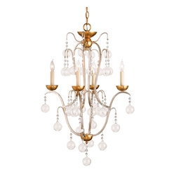 Allusion Chandelier - Silver Leaf & Gold Leaf - The loftiest of lively traditional ornaments to a grand salon or a divine dining room, the Allusion Chandelier completes such a graceful design by alighting with elements that curl and float for a dainty look of weightlessness.  Candle bulbs poise at the crests of sleek golden spirals, while a rain of clear glass bulbs are held motionless at the ends of delicately scintillating beaded chains, an endless rain of beauty for a room to remember.