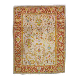 A Late 19th Century Turkish Oushak  Wool Rug - A Late 19th Century Turkish Oushak  Wool Rug with an asymmetrical pattern, rendered in colors of yellow, green, red, blue, and cream