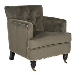 Safavieh Colin Tufted Club Chair - Graphite - You don't have to be a smoker to fall in love with the Safavieh Colin Tufted Club Chair - Graphite, but you might feel an urge to pick up a pipe just for nice effect. This handsome club-styled smoking chair has a deep seat that you'll love sinking into, with its plush seat cushion, button-tufted back, and relaxing high arms. A timeless style with both clean modern lines and traditional ornamentation, like the turned front legs and the silver nail head trim, this chair beautifully complements any decor. The smoky graphite-colored cotton upholstery has a sophisticated look that will imbue any room with a classic elegance. The durable cotton blend and birch wood constructed frame create a beautiful and sturdy piece that will stay looking nice for years to come.About SafaviehConsidered the authority on fine quality, craftsmanship, and style since their inception in 1914, Safavieh is most successful in the home furnishings industry thanks to their talent for combining high tech with high touch. For four generations, the family behind the Safavieh brand has dedicated its talents and resources to providing uncompromising quality. They hold the durability, beauty, and artistry of their handmade rugs, well-crafted furniture, and decorative accents in the highest regard. That's why they focus their efforts on developing the highest quality products to suit the broadest range of budgets. Their mission is perpetuate the interior furnishings craft and lead with innovation while preserving centuries-old traditions in categories from antique reproductions to fashion-forward contemporary trends.